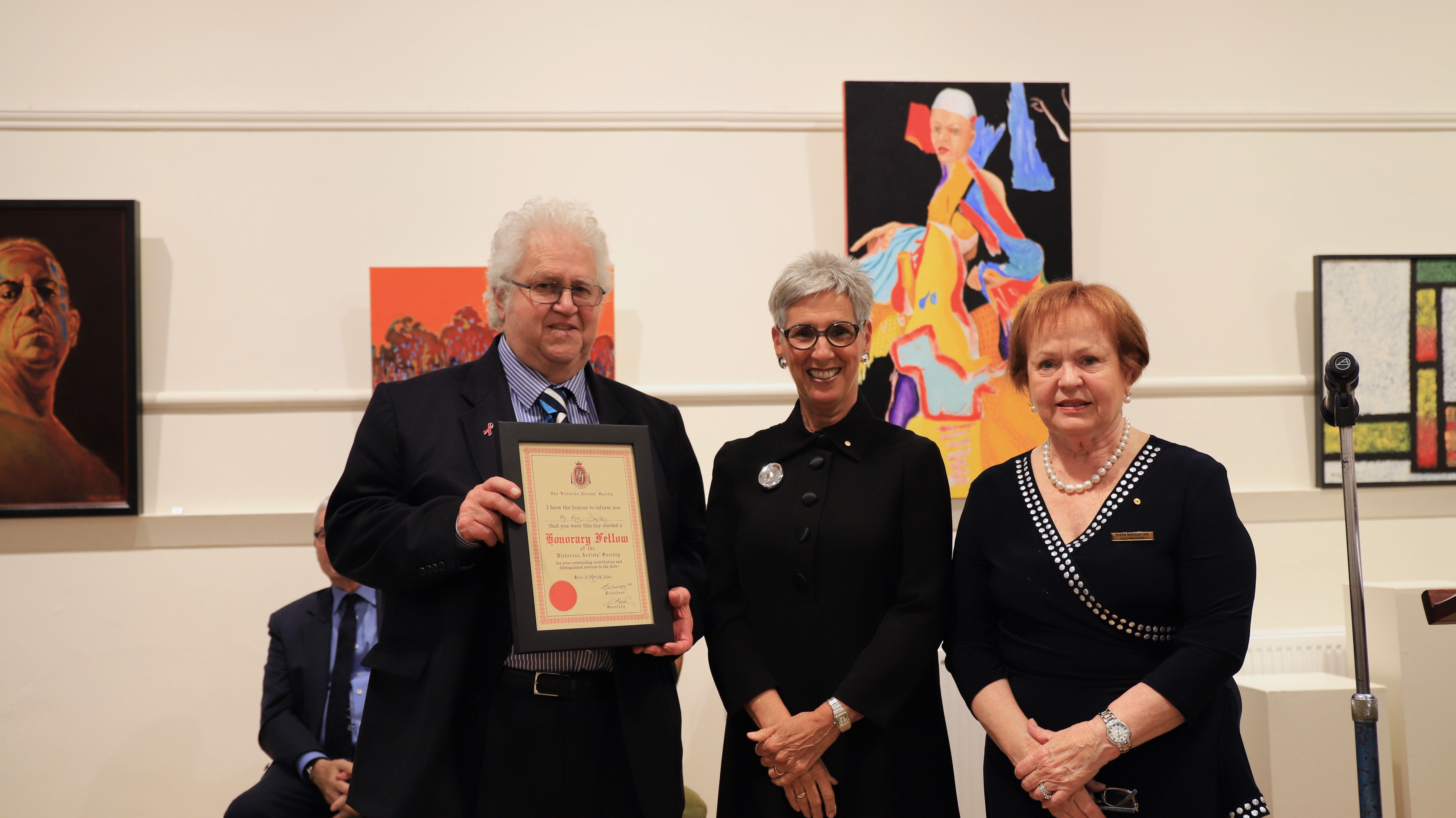 Ron Smith receiving his award from the governor