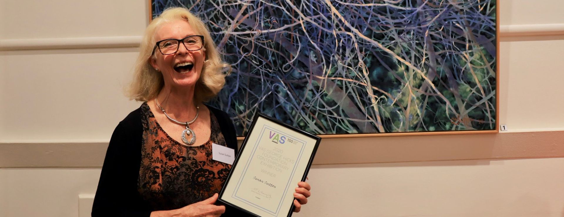 150th Anniversary Event Image prize winner with painting